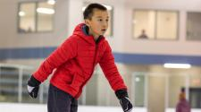 This image shows a boy ice skating.