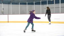 This image shows a girl ice skating.
