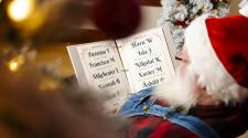 This image shows Santa reading his naughty and nice list.