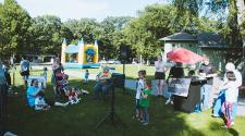 This image shows two kids singing karoke to a small crowd at Gathering on Tuesday's.