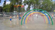 This image shows the splash pad at Madison Pool & Splash Pad.