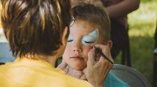 This image shows face painting at Midwest Kids Fest.