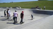 This image shows a group of skateboarders at the skate park.