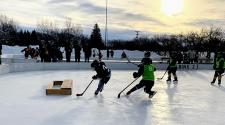 This image shows a player scoring at youth pond hockey.